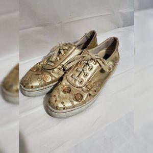 Stuart by Stuart Weitzman Gold Medallion Sneakers